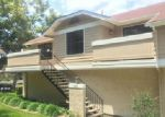 Foreclosed Home in Stanton 90680 12616 MOORDALE CIR # 210 - Property ID: 3981042