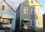 Foreclosed Home in Chicago 60609 4955 S WOOD ST - Property ID: 4154844