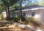 Foreclosed Home in Oak Island 28465 208 E OAK ISLAND DR - Property ID: 4305469