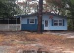 Foreclosed Home in Oak Island 28465 133 NW 7TH ST - Property ID: 4339789